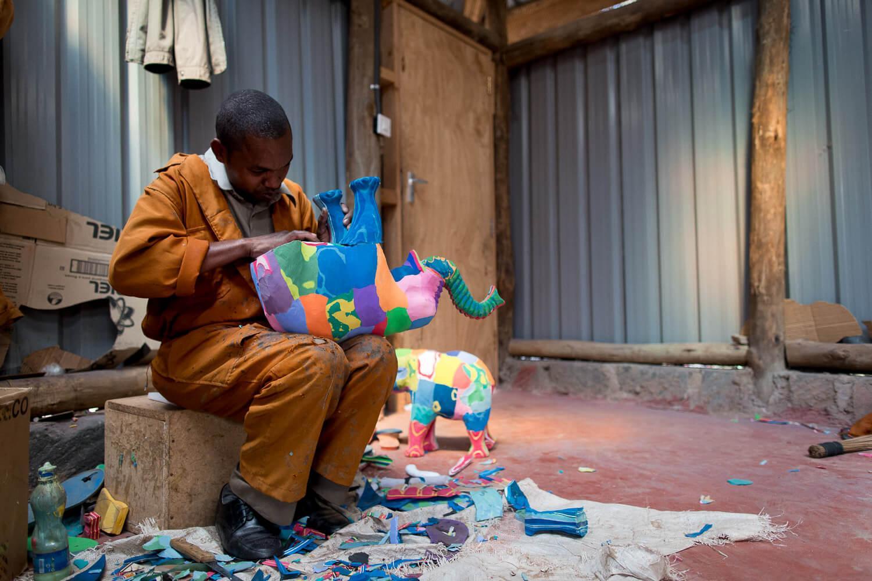 An Ocean Sole artisan finalizes an elephant made from recycled flip flops. © Jaymi Heimbuch