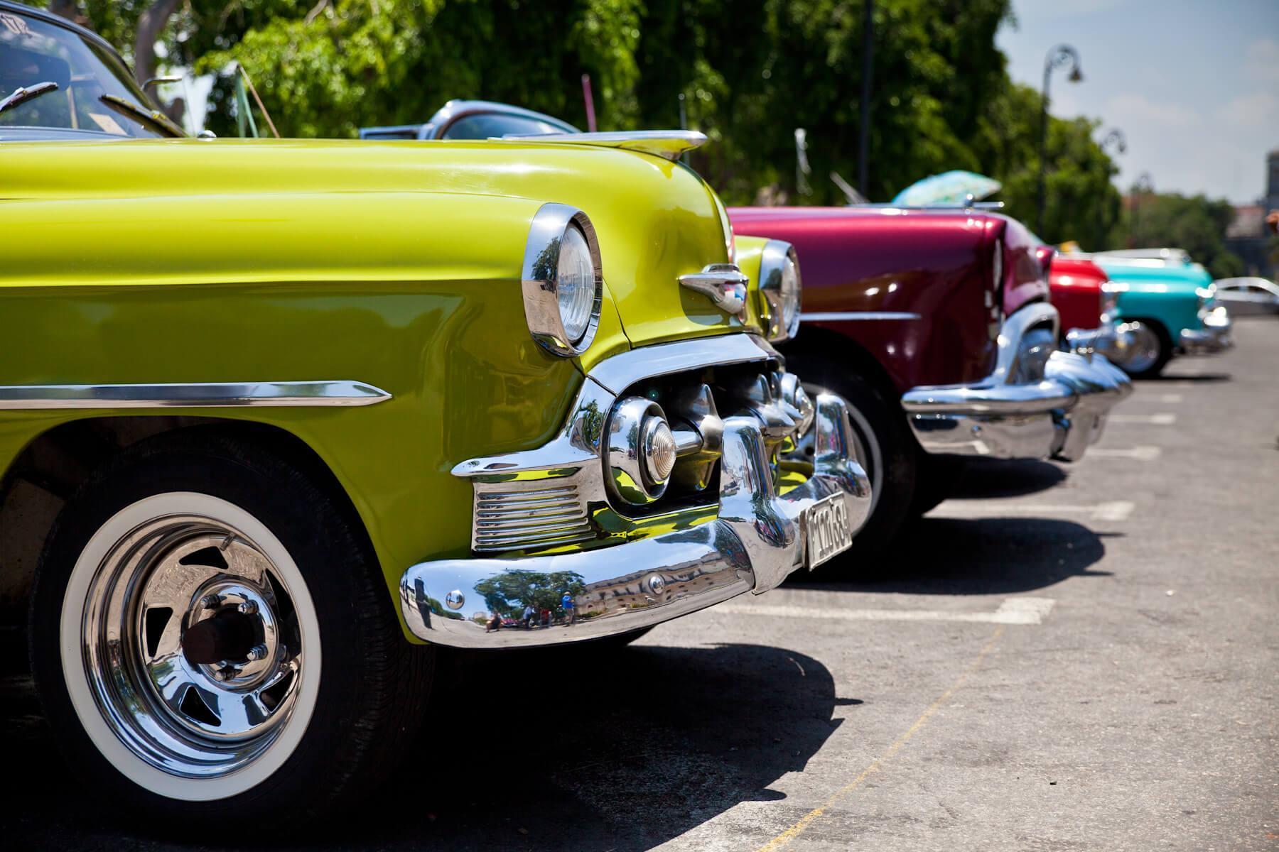 Classic cars line the streets of Havana. © Brian J. Hutchinson