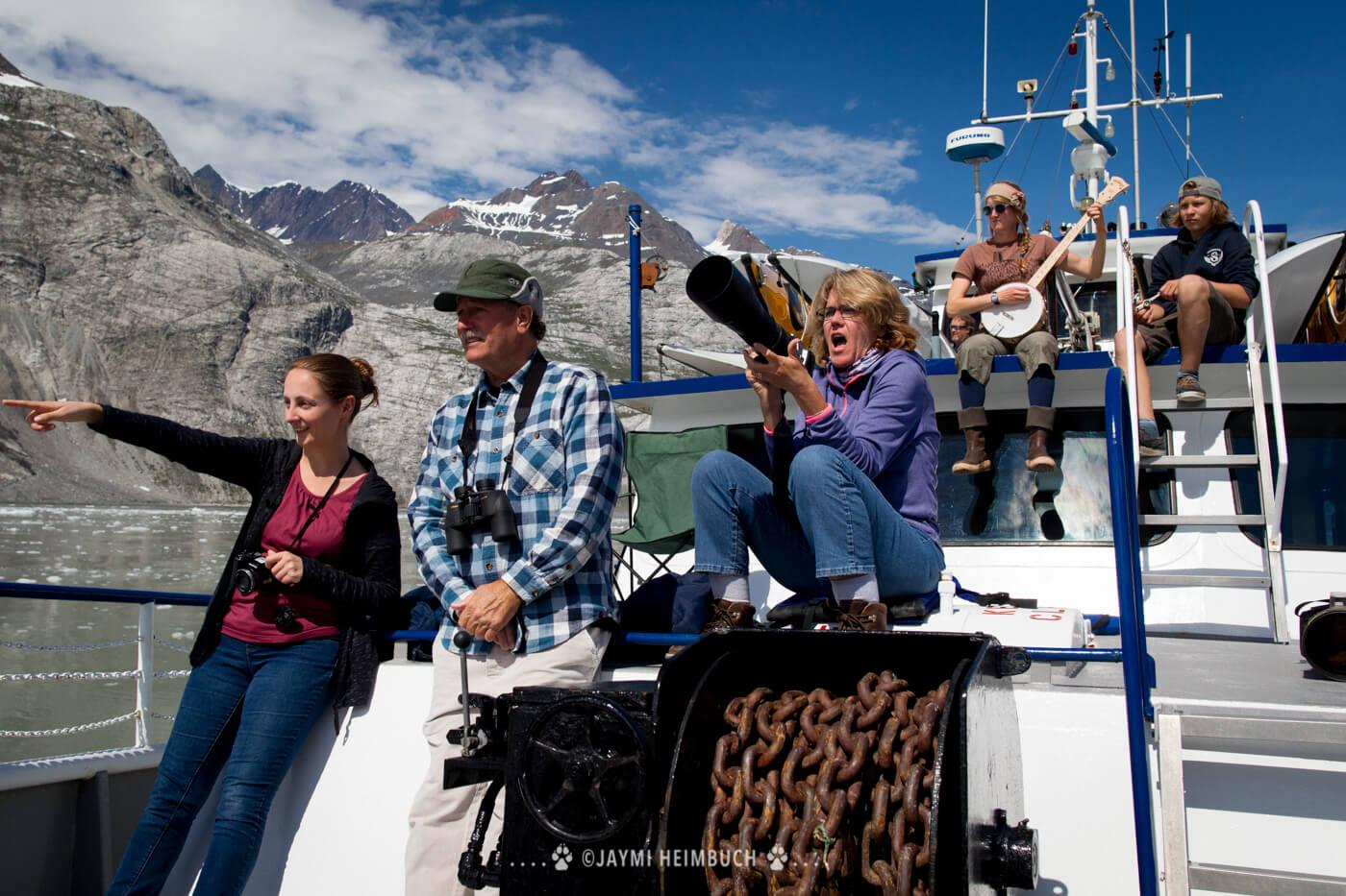 Passengers and crew observe wildlife from the ship's deck. © Jaymi Heimbuch