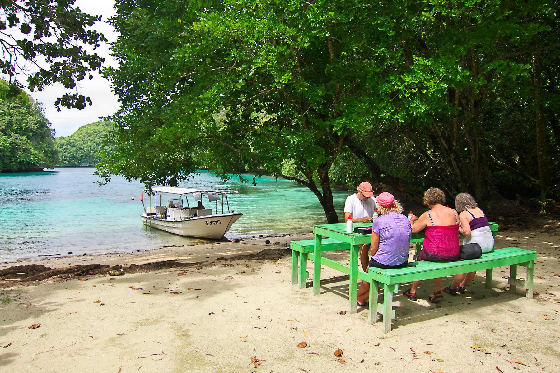 Travelers enjoy a picnic lunch in the Rock Islands. © Keoki Stender