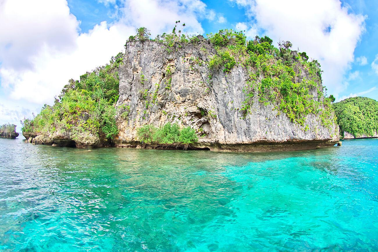 The Rock Islands offer dramatic landscapes while above water. © Keoki Stender